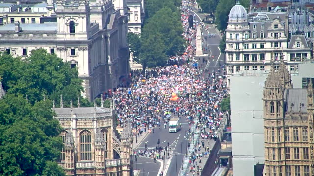 High angle view of crowds and the 'Baby Trump' balloon in London during President Trump's first visit to the UK as President
