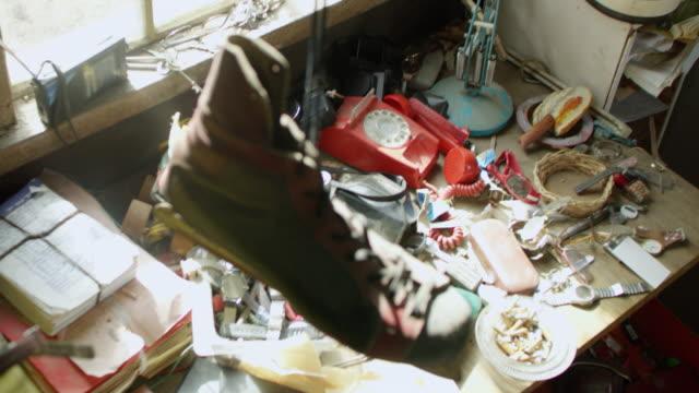 "vídeos de stock, filmes e b-roll de "" high angle view of dirty and broken equipment on table"" - mesa mobília"