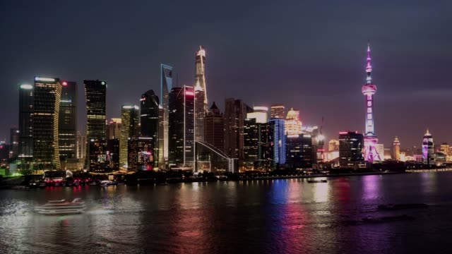 T/L WS HA ZO High Angle View of Downtown Shanghai, Day to Night Transition / Shanghai, China