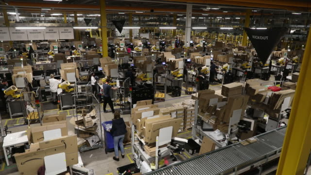 high angle view of employees work at the amazon warehouse in kegworth, uk ahead of amazon prime day event on monday, october 12, 2020. - cardboard box stock videos & royalty-free footage