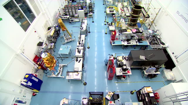 high angle view of engineers working in a space technology laboratory - satellite stock videos & royalty-free footage