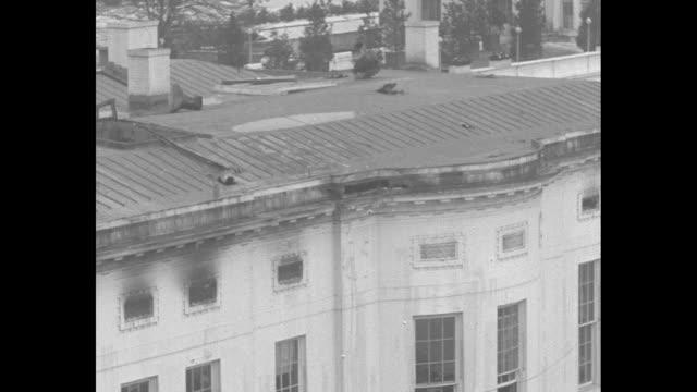 vidéos et rushes de high angle view of fire-damaged west wing - la maison blanche