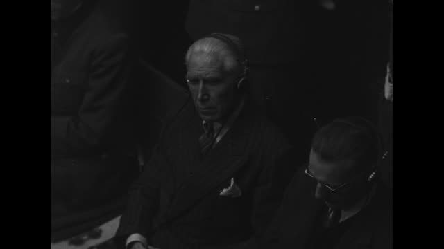 mcu high angle view of german ambassador fritz von papen listening during war crimes trial with nazi chancellor of austria arthur seyssinquart to his... - war crimes trial stock videos and b-roll footage
