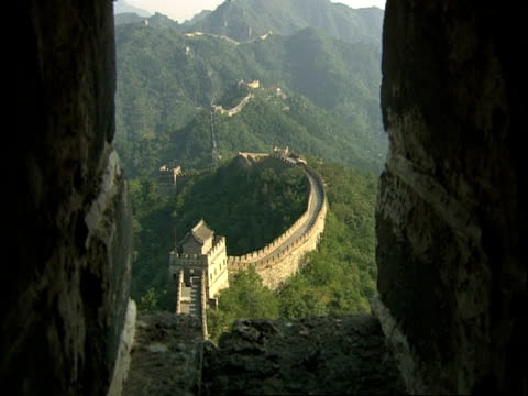 high angle view of great wall of china from rampart, mutianyu, china - mutianyu stock videos & royalty-free footage
