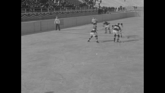 vs high angle view of hockey teams on rink / vs closer view of teams / note exact day not known - lake placid town stock videos and b-roll footage