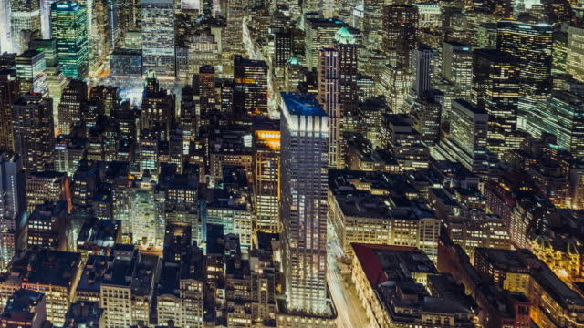 t/l ha high angle view of illuminated skyscrapers at night / manhattan, nyc - population explosion stock videos & royalty-free footage