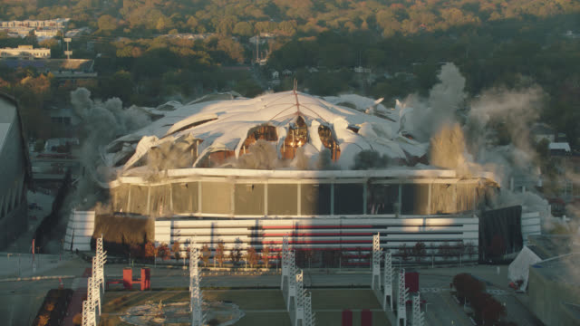 "slo mo. high angle view of implosion of georgia dome stadium ""georgia world congress center"" on november 20, 2017, in downtown atlanta, georgia. - imploding stock videos and b-roll footage"