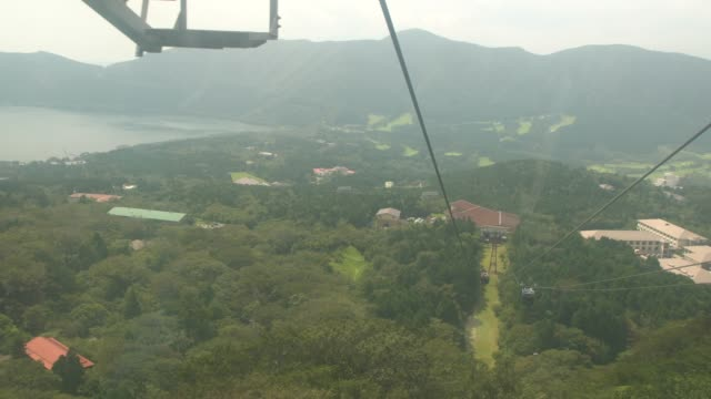 high angle view of lake ashi and hakone  from hakone ropeway, hakone, japan - overhead cable car stock videos and b-roll footage