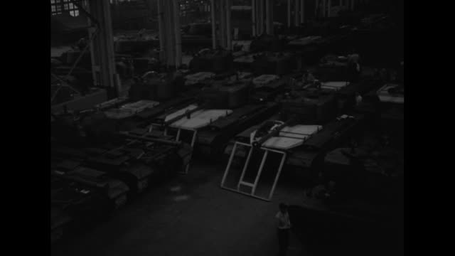 High angle view of M46 Patton tanks on factory floor / Note exact day not known