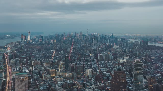 t/l high angle view of manhattan skyline at dusk - traffic time lapse stock videos & royalty-free footage