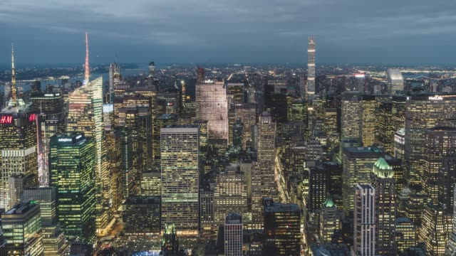 T/L PAN High Angle view of Manhattan Skyline, from Dusk to Night