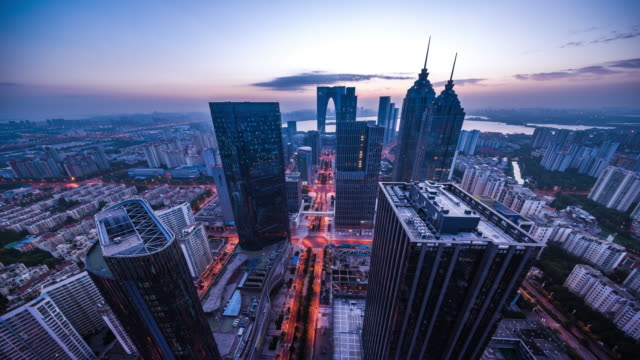 high angle view of modern city night to day transition - 東方明珠塔点の映像素材/bロール