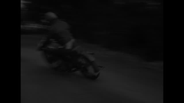 ms high angle view of motorcycle driven on dirt track / ms low angle motorcycles ride into frame on either side of camera proceed into distance / vs... - endurance stock videos & royalty-free footage