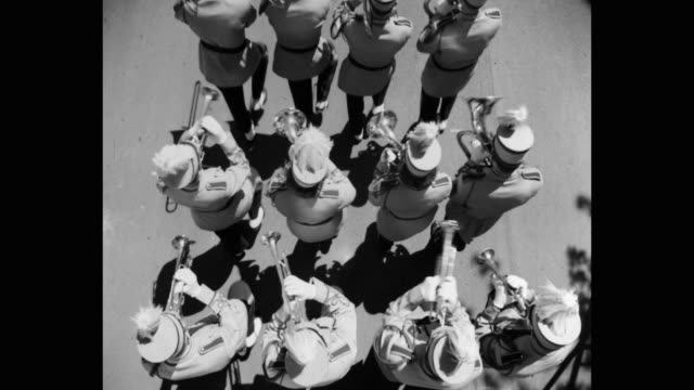 high angle view of musical band marching on street - marching stock videos & royalty-free footage