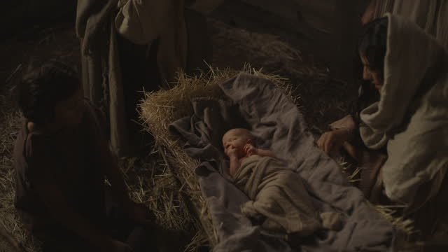 high angle view of nativity scene of shepherds visiting baby jesus with mary and joseph / cedar hills, utah, united states - genderblend stock videos & royalty-free footage
