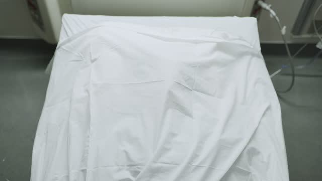 high angle view of nurses covering dead patient with sheet in hospital / salt lake city, utah, united states - sheet stock videos & royalty-free footage