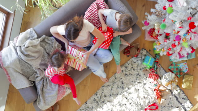 high angle view of opening christmas presents - giving stock videos & royalty-free footage