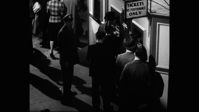 1939 high angle view of people buying tickets at madison square garden, new york city, new york state, usa - new york city 1930s stock videos & royalty-free footage