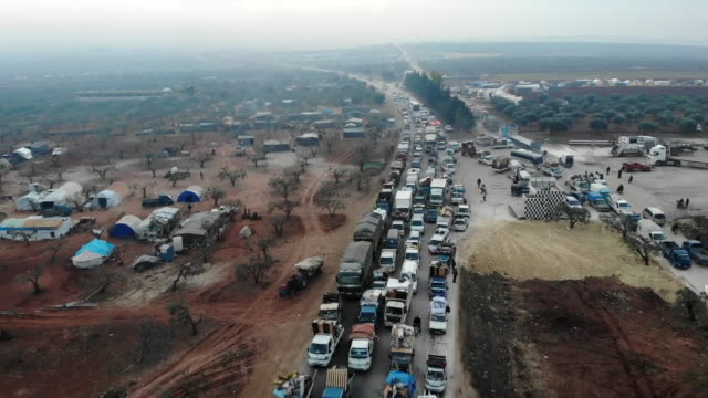 high angle view of people fleeing idlib, syria - escaping stock videos & royalty-free footage