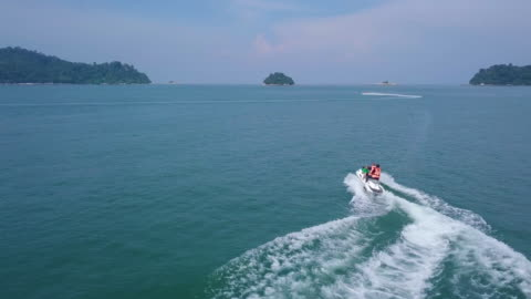 high angle view of people sitting at watercraft with leisure activity - speed boat stock videos & royalty-free footage