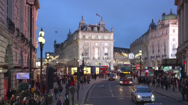 a high angle view of piccadilly circus,  london at dusk. - piccadilly circus stock videos and b-roll footage