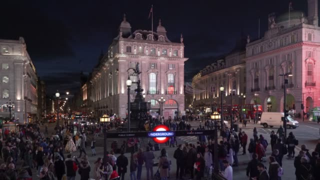 a high angle view of piccadilly circus, london, at night. - british culture stock videos & royalty-free footage