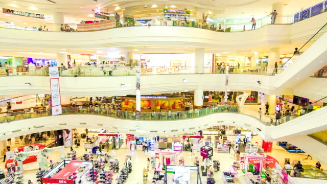 high angle view of poeple in shopping mall - shopping centre stock videos & royalty-free footage