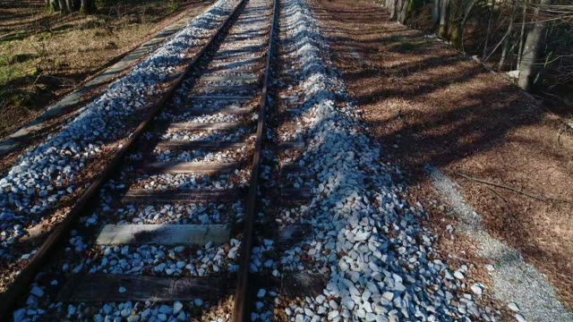 high angle view of railroad tracks thru nature - tramway stock videos & royalty-free footage