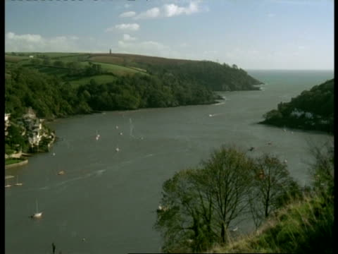 t/l wa high angle view of river dart leading out to sea, pan left to kingsbridge town, dartmouth, boats and ferries on river - dartmouth england stock videos & royalty-free footage