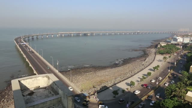 High angle view of road beside the promenade and pan left to right to traffic along the Bandra Worli Sea Link High angle view of road intersection at...
