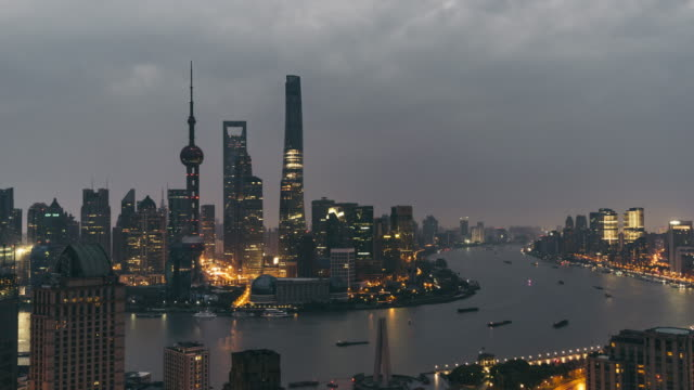 t/l ws ha zo high angle view of shanghai skyline, dawn to day transition / shanghai, china - dawn to day stock videos & royalty-free footage