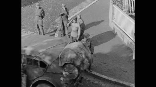 high angle view of soviet and us soldiers saluting to us army vehicles as they pass by, post wwii germany - postwar stock videos & royalty-free footage
