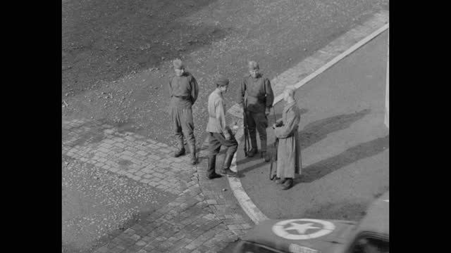 high angle view of soviet soldiers watching armored vehicles driving on street, post wwii germany - postwar stock videos & royalty-free footage