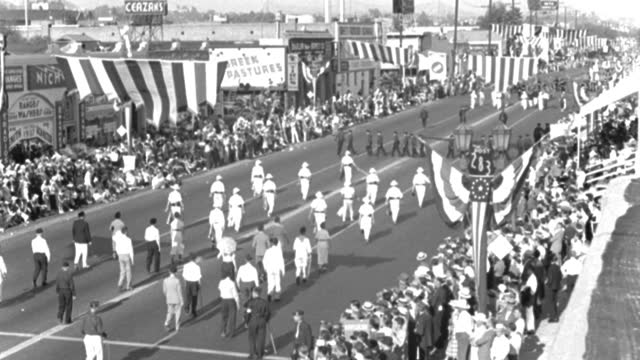 high angle view of spectators watching american legion parade on sunset boulevard near the athletic club, in august, 1936. boy scout band followed by sailors marching in city - 1936 stock videos & royalty-free footage