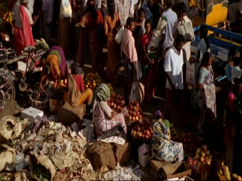 mcu high angle view of street markets selling fruit, people moving past, madras - chennai stock videos & royalty-free footage