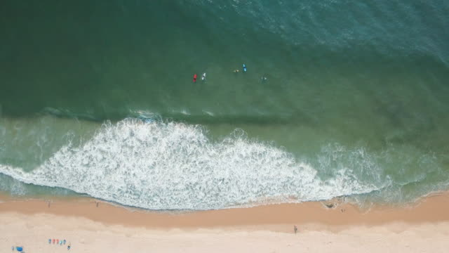 High angle view of surfers in ocean waves