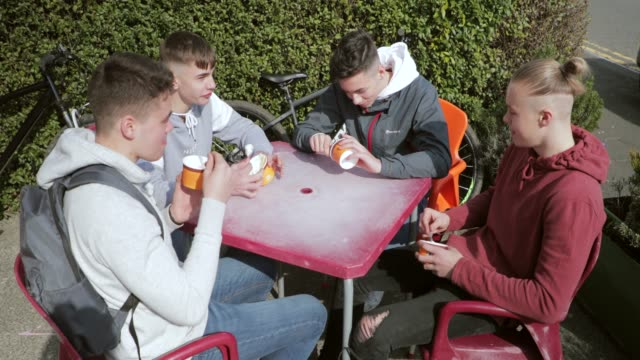 high angle view of teens eating ice-cream - day in the life stock videos & royalty-free footage
