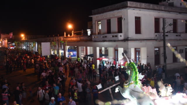 High angle view of the general crowd met in the town's main street celebrating the more than 100 years festival The image is framed on the float of...