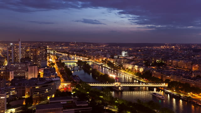 T/L WS High Angle view of the Seine River and urban traffic at dusk / Paris, France