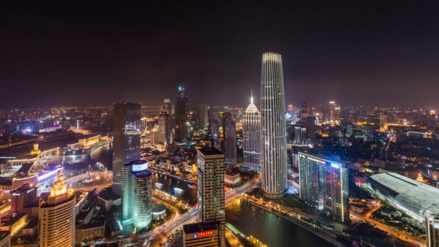 t/l ws ha pan high angle view of tianjin skyline at night - tianjin stock videos and b-roll footage