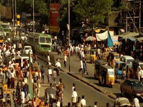ms high angle view of traffic and people moving through indian city street, madras - chennai stock videos & royalty-free footage