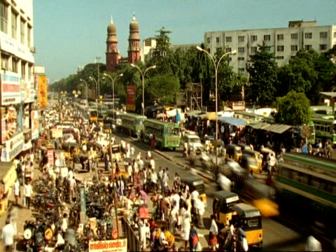t/l wa high angle view of traffic and people moving through indian city street, madras - chennai stock videos & royalty-free footage