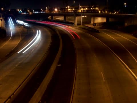high angle view of traffic moving on the road - 乗り物の明かり点の映像素材/bロール