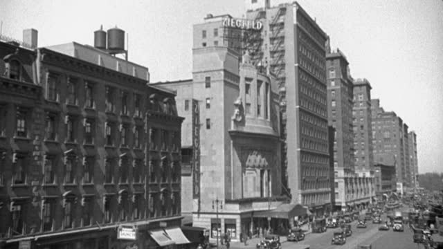 high angle view of traffic on busy street passing by ziegfeld theater on 6th avenue and 54th street, manhattan, new york city, new york state, usa - 1928 stock videos & royalty-free footage