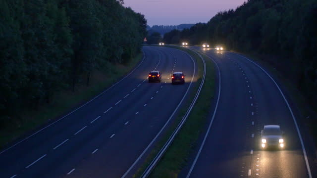 high angle view of traffic on road at night - headlight stock videos & royalty-free footage