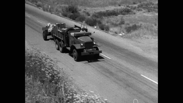high angle view of us marine vehicles driving on country road - three people stock videos & royalty-free footage