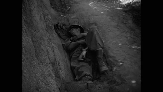 high angle view of us soldier sleeping in ditch - lying on back stock videos & royalty-free footage