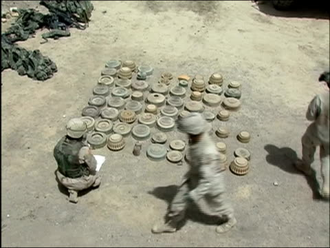 high angle view of us troops carefully laying mines on the ground / ghazni afghanistan / audio - instruction manual stock videos and b-roll footage