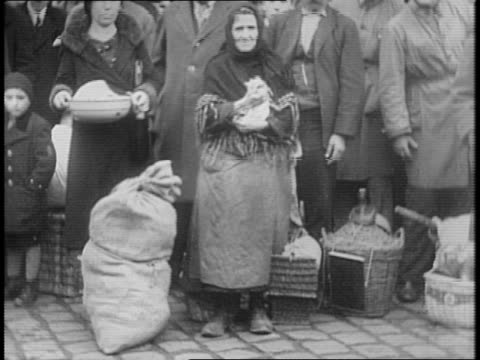 high angle view of zagreb, croatia / montage of yugoslavian, serbian, and croatian refugees from nazi invasion with children, belongings, and pets /... - serbia stock videos & royalty-free footage