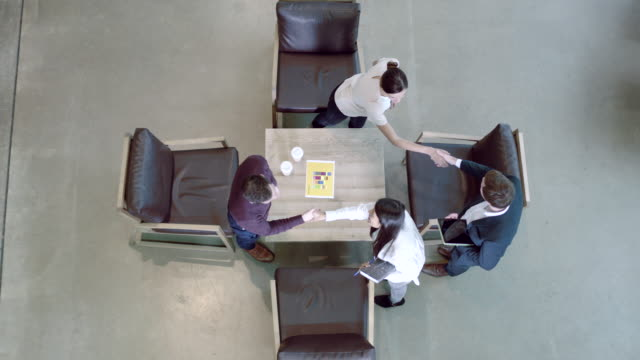 High angle view on business meeting in office lobby